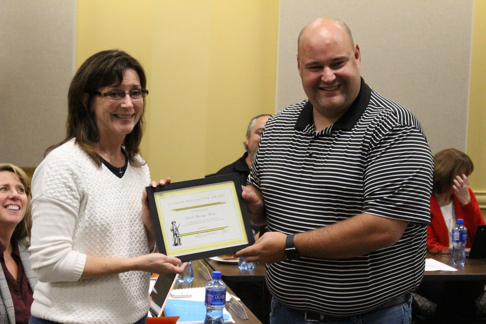 Nov. 06, 2017. Board of Ed member Krista Polanski presents Sand Springs Home representative Erik Stuckey with the Pacesetter Award for a $10,000 STEM donation.