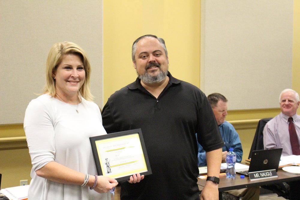 Nov. 06, 2017. Board of Ed President Rusty Gunn presents Lori Wilkinson with the Pacesetter Award.