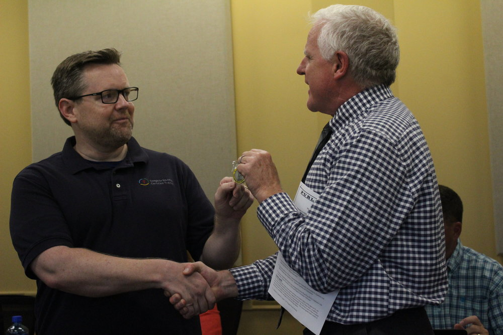 Aug. 07, 2017. Technology Director Shawn Beard is presented with a Coin of Excellence by SSPS Board of Ed member Mike Mullins.