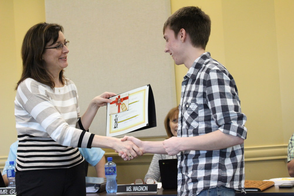April 03, 2017. SSPS Board of Ed member Krista Polanski presents All-State Band member Jake Thompson with the Sandite Spirit Award.