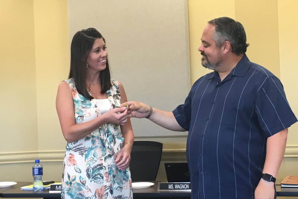 July 10, 2017. Laura Hamilton is presented with a Coin of Excellence by SSPS Board of Education President Rusty Gunn.