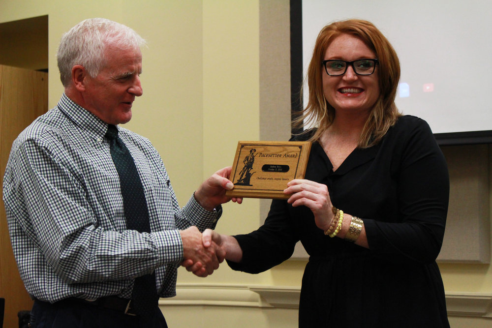 Oct. 03, 2016. Board of Ed President Mike Mullins presents Andrea Brice with the Pacesetter Award.