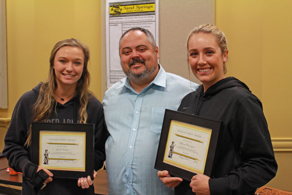 Dec. 05, 2016. Rusty Gunn presents Sydney Pennington and Jessica Collins with Sandite Spirit Awards for making the All-State Softball