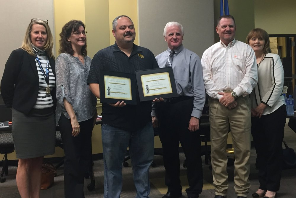 The Sand Springs Board of Education presents Rusty Gunn with Sandite Spirit Awards for Church That Matters and Inkwell Printing.