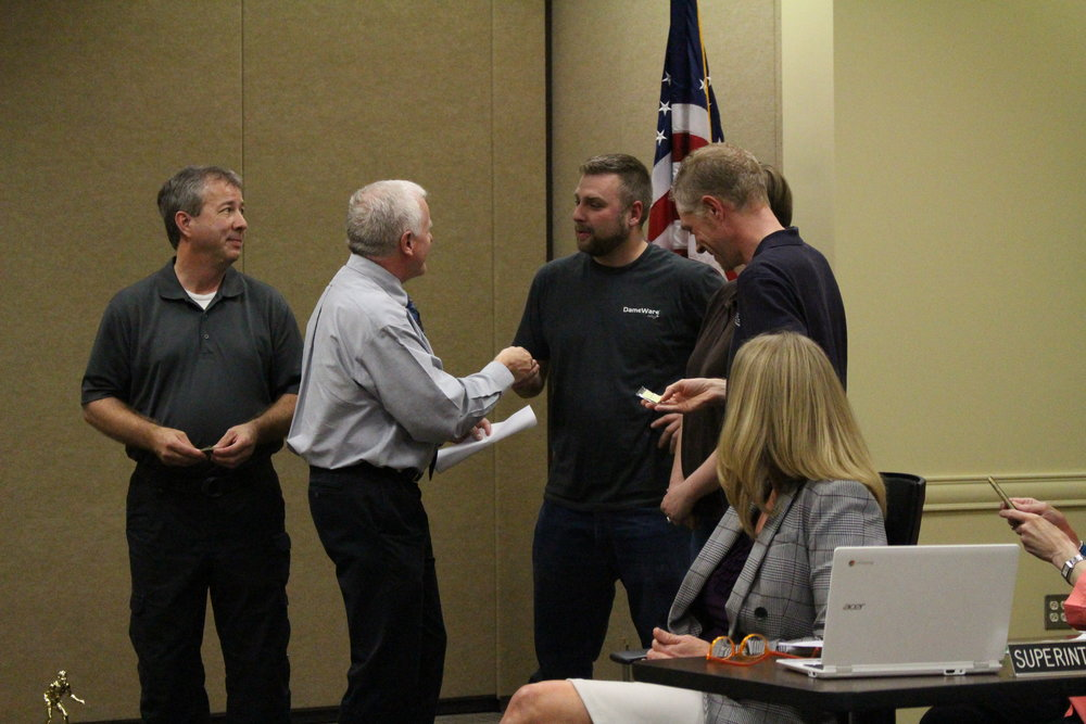 Mar. 06, 2017. Mike Mullins presents Bob Jackson, Ryan Dannar, and Eric Hartley with Pacesetter Awards.