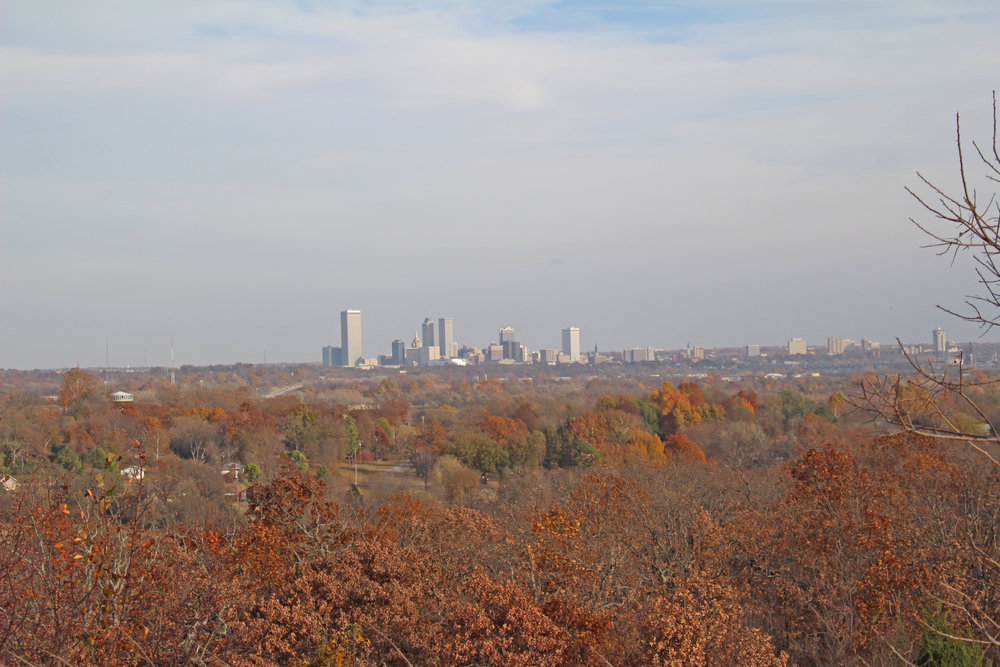 "The downtown tulsa skyline is visible from many elevated parts of sand springs, which is just a few miles west of the former ""oil capital of the world."""
