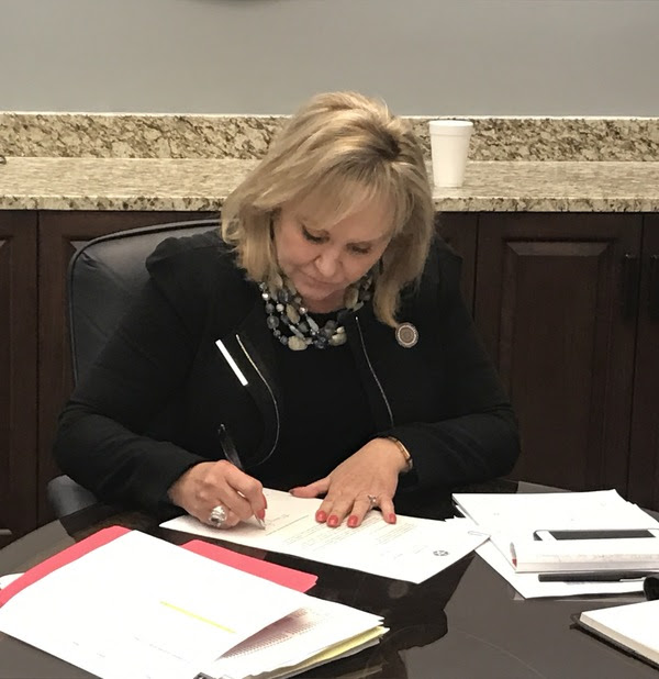 Governor Mary Fallin signs paperwork vetoing most of House Bill 1019X, a revised budget bill approved by legislators in special session. 171117 Courtesy Photo.jpg