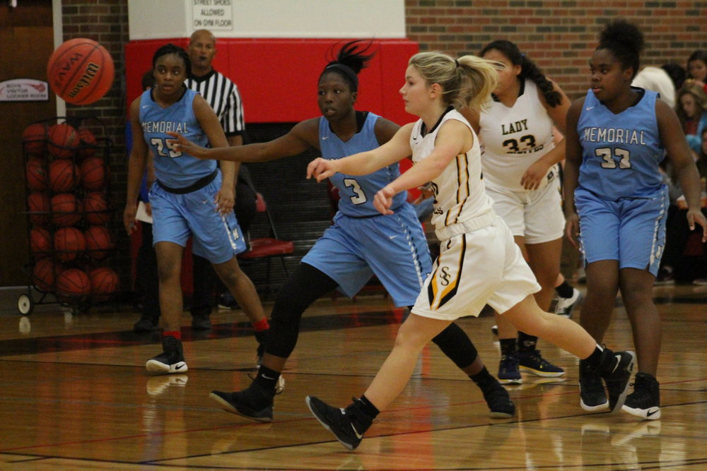 Pictured: Jade Shrum scored her first points in varsity action with a fourth-quarter three-pointer against Tulsa Memorial. (Photo: Scott Emigh).