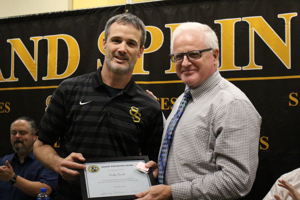 Dec. 04, 2017. Board of Ed member Mike Mullins presents Head Wrestling Coach Kelly Smith with a Pacesetter Award and Coin of Excellence.