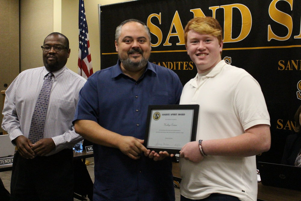 Dec. 04, 2017. CBMS Ass. Principal JJ Smith and Board of Ed President Rusty Gunn present Korbyn Cowan with a Sandite Spirit Award.