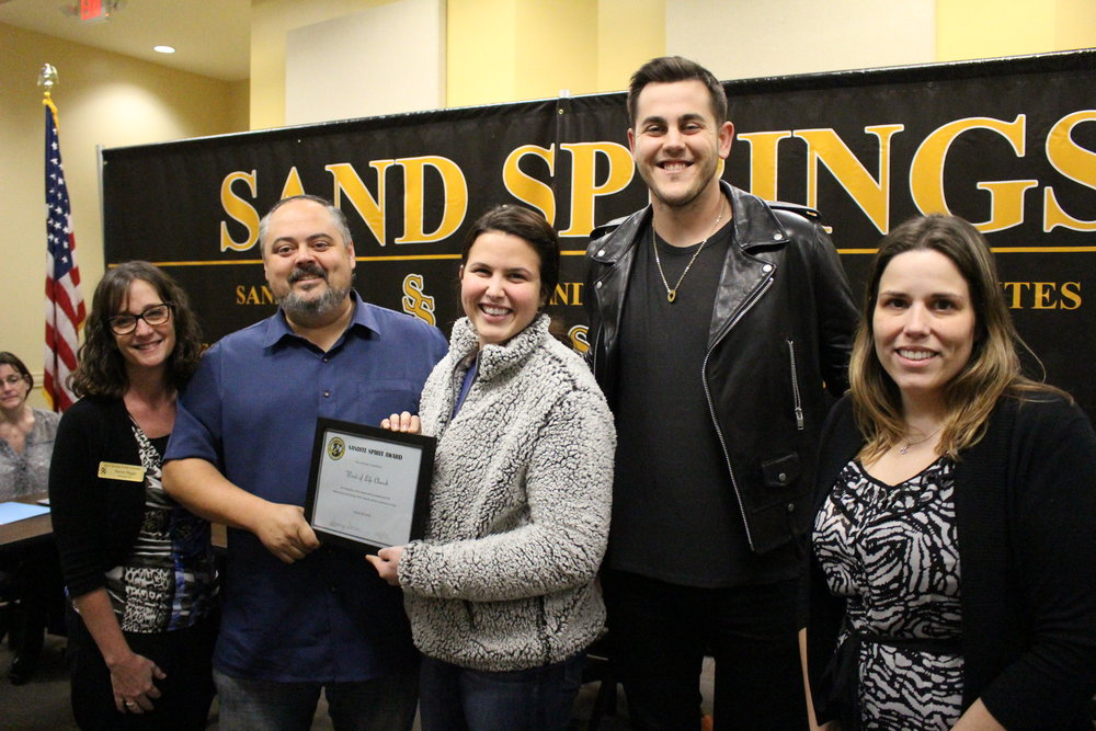 Dec. 04, 2017. Limestone Principal Karen Biggs, Board of Ed President Rusty Gunn, and Angus Principal Angelia Noel present Word of Life Children's Pastor Alexis and Grant Glaze with a sandite spirit award.