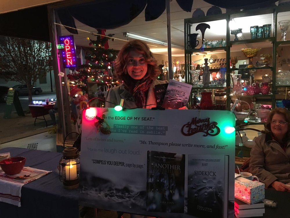 Former Sand Springs Leader editor Tara Lynn Thompson showcases her latest novel at the Inaugural Christmas Parade of Books. 171201 (Scott Emigh).jpg
