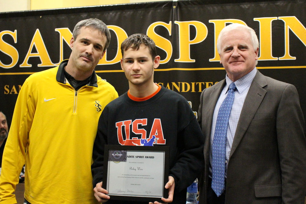 mar. 05, 2018. cphs head wrestling coach Kelly Smith and board of ed member Mike Mullins present Riley Weir with a Sandite Spirit Award.