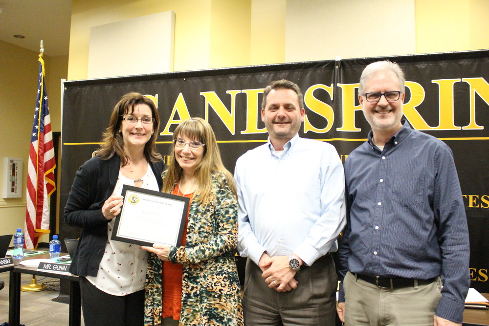mar. 05, 2018. SSPS Board of Ed member Krista Polanski (left) presents Amanda Teachnor with a Pacesetter Award, accompanied by band director Kyle Wright and choir director Peter Whipple.
