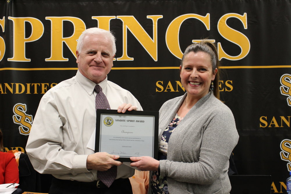 Feb. 05, 2018. Board member mike mullins presents champions representative melissa torkleson with a sandite spirit award.
