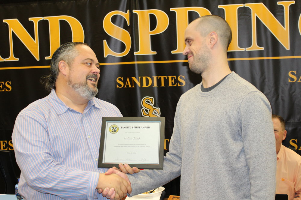 feb. 05, 2018. board president rusty gunn presents solace church missions pastor ryne isaac with a sandite spirit award.