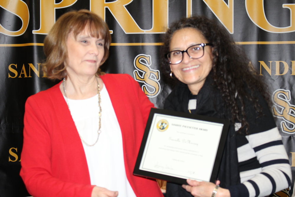 feb. 05, 2018. board member jackie wagnon presents graciella demurray with a pacesetter award.