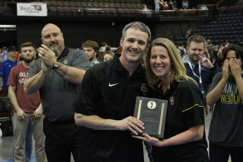 SSPS Superintendent Sherry Durkee presents CPHS Head Wrestling Coach Kelly Smith with the coach's plaque after winning the 2017 Dual State Championship. (Photo: Scott Emigh).
