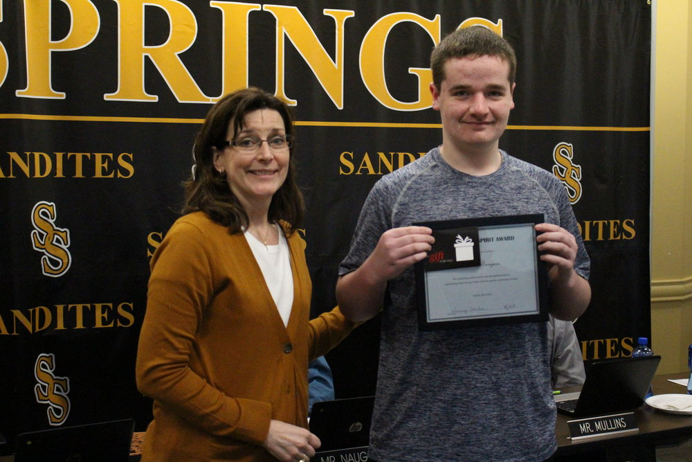 Apr. 02, 2018. SSPS Board of Ed member Krista Polanski presents Mason Turgeon with a Sandite Spirit Award.
