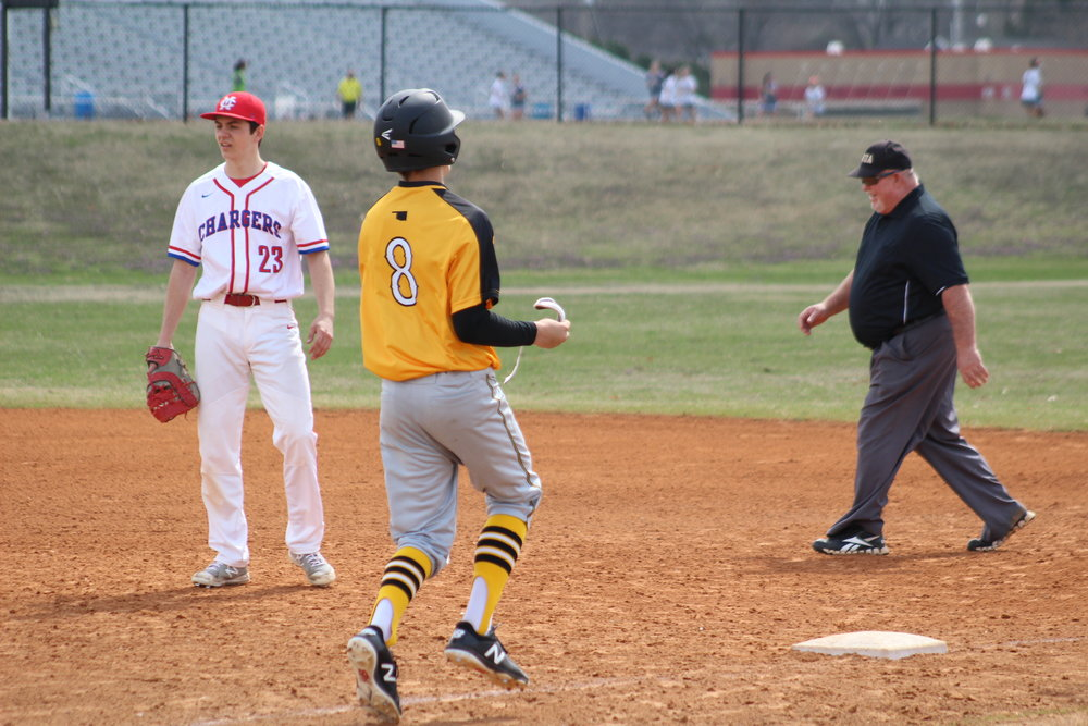 Cal Watkins scored both runs in a 2-0 win at Booker T. Washington High School.