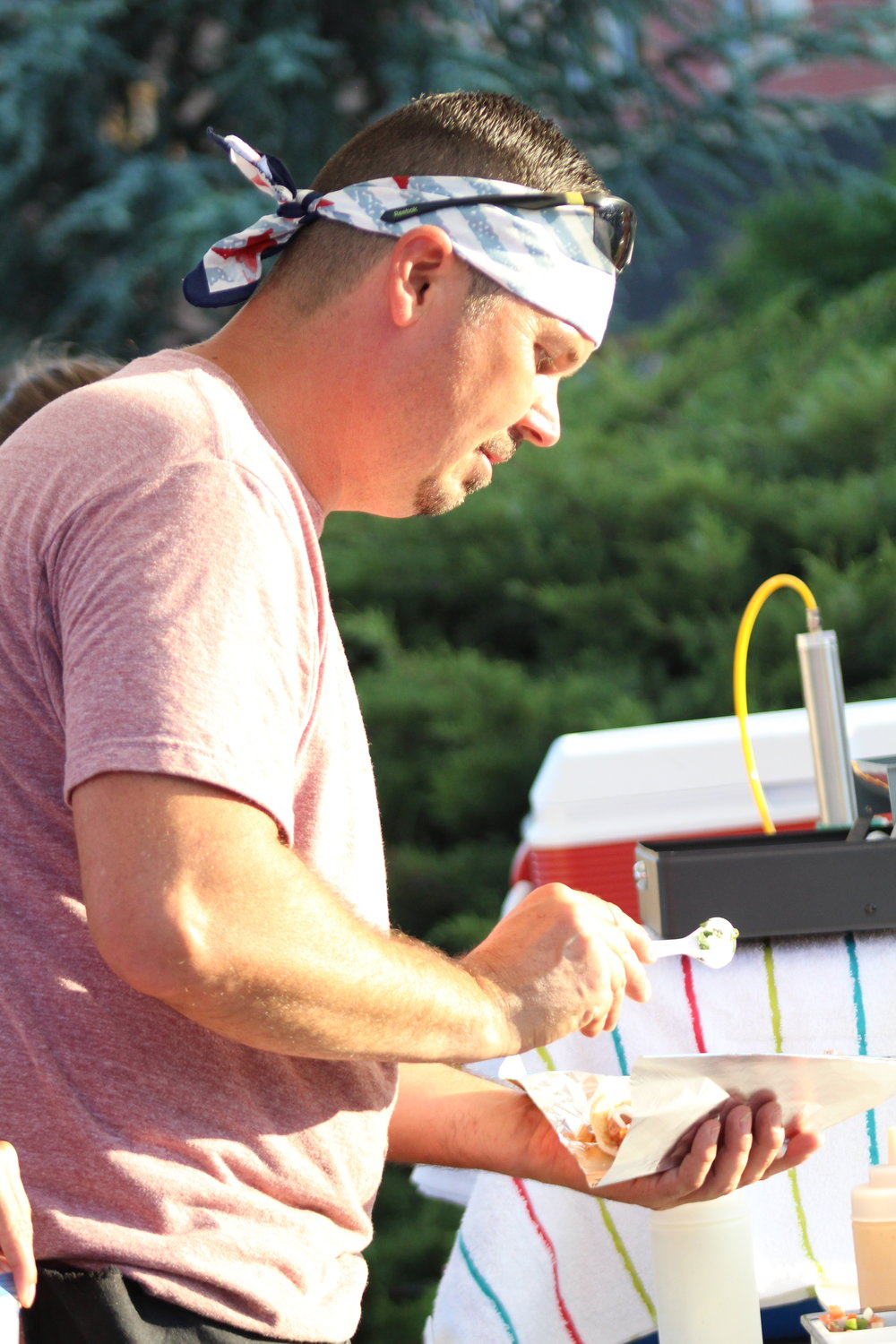 Jeremy Myers, Kingdom Concessions, serves up Sonoran hot dogs at Tuesday on the Triangle.