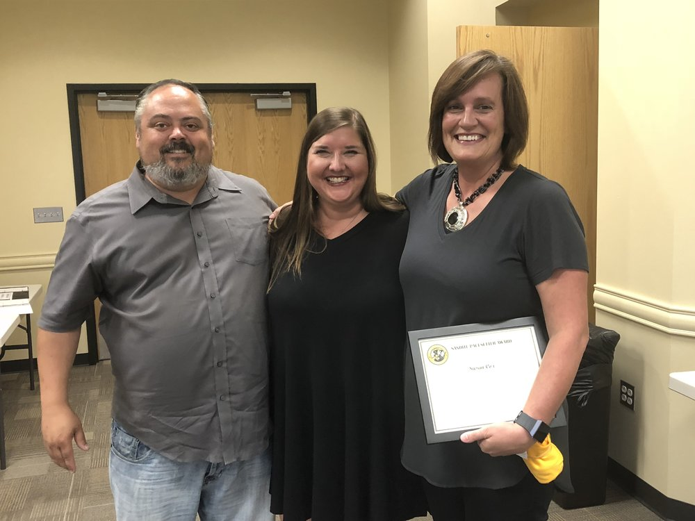 Sand Springs Board of Education member Rusty Gun (left) and Charles Page High School Cheer Coach Carrie Schlehueber (center) present Susan Cox (right) with a Pacesetter Award.   Click here to view full photo gallery.