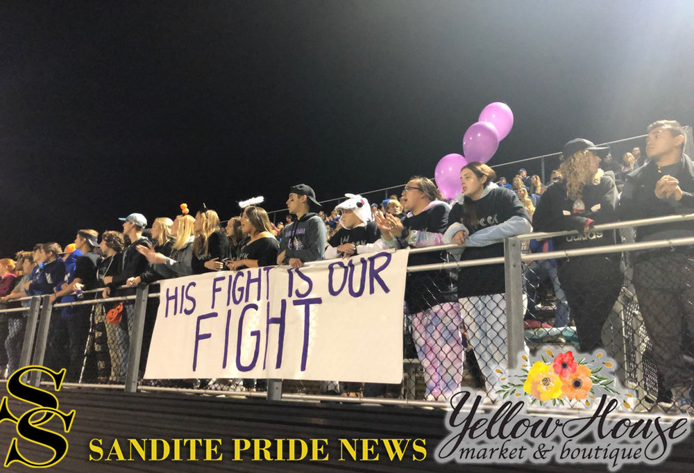 The Sapulpa Student Section shows their support for CPHS Head Coach Dustin Kinard and his battle with pancreatic cancer. (Photo: Morgan Miller).