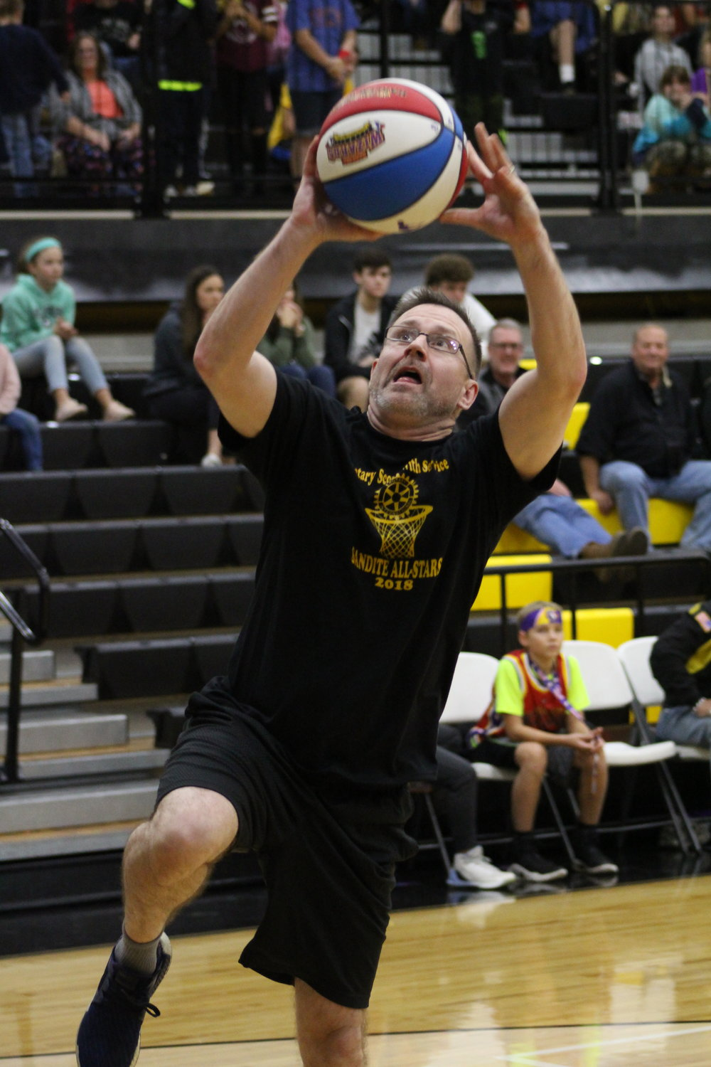 HillSpring Pastor Brent Kellogg goes for a layup in Thursday's exhibition match against the Harlem Wizards. (Photo: Scott Emigh).    Click here to view full photo gallery.