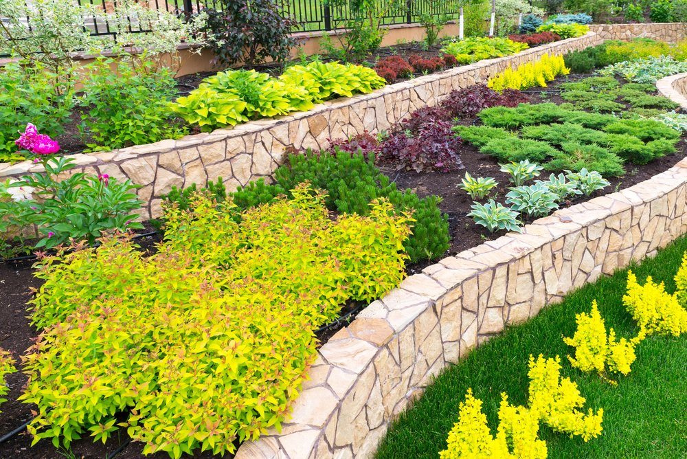STONE RETAING WALL WITH LANDSCAPING 2.jpg