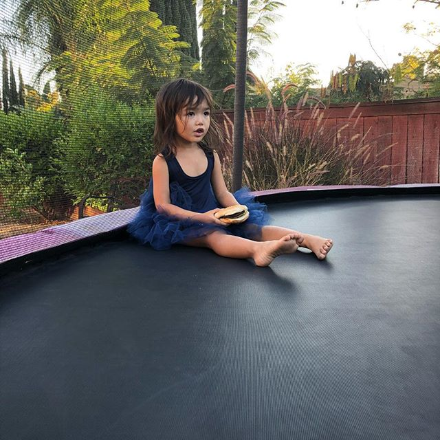 Eating a burger in a tutu on the trampoline 😂 #littleprincess #socal #bbq