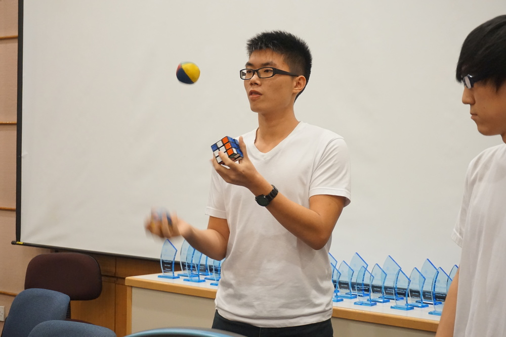 Me juggling while solving a Rubik's Cube