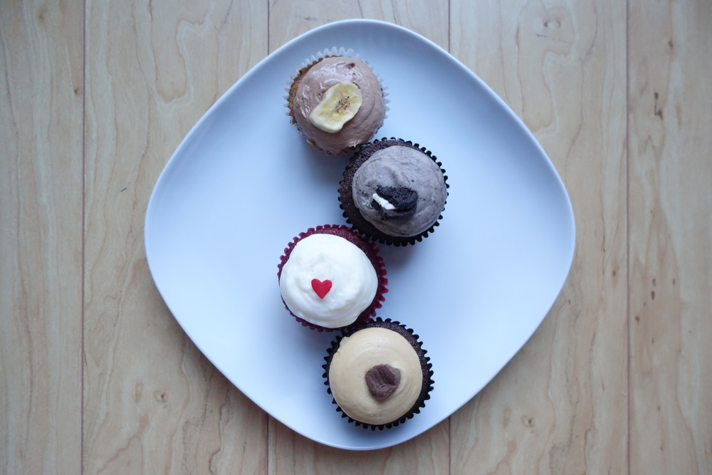 Cupcakes by We The Minis. From Top: Banana Nutella, Cookies n' Cream, Red Velvet & Peanut Butter Cup  .