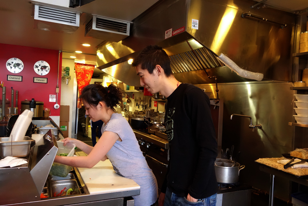 Stacy Tang (Left) & husband, Willy Wang (Right) preparing food at Taiwan Bento.