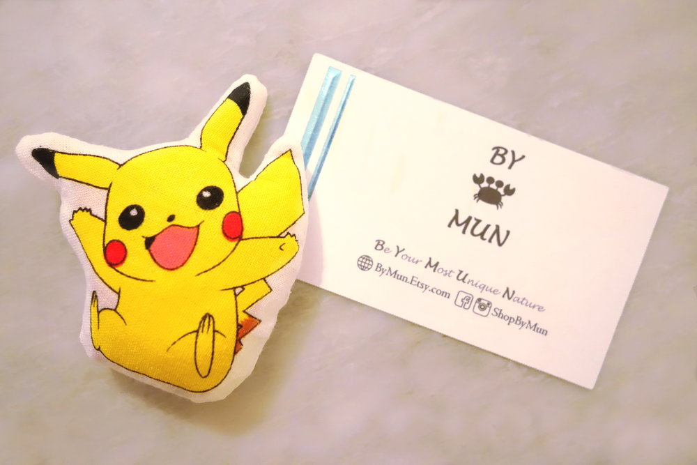 Pikachu Pillow (Left) & BYMUN Business Card (Right)