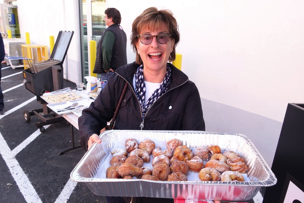 "Susan Brennan , Goodwill SFSMM Board Member poses with a tray of homemade donuts to support ""Donuts for Donations"""