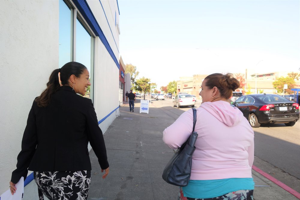 Tanya Moore  - VP of Mission Advancement at Goodwill San Francisco, walks with a prospective job seeker to the Career and Job Training Center around the corner from the Goodwill San Rafael Retail Store