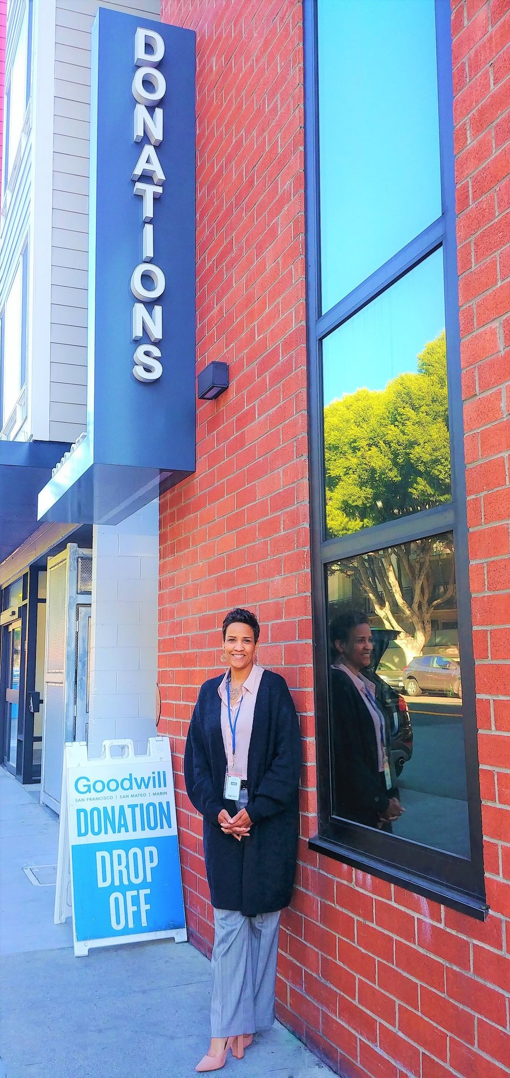 Freda Marshall  - Director of Learning & Development, in front of the Donation Center at Goodwill SF