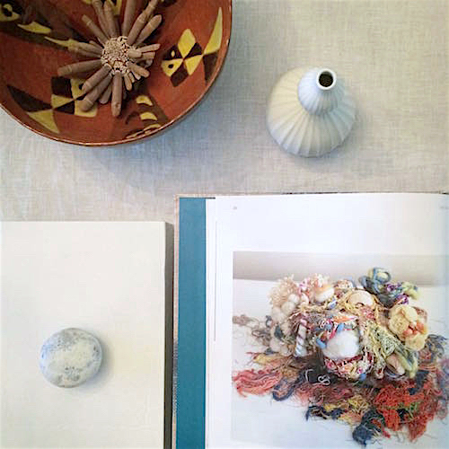 Slow Stitch: Mindful and Contemplative Art open on my work table in Manhattan. This chapter highlights ideas related to 'locality and localism'. The ceramic piece on the upper left is by my mother-in-law, Elvira Andreani, who now lives near Siena, Italy.
