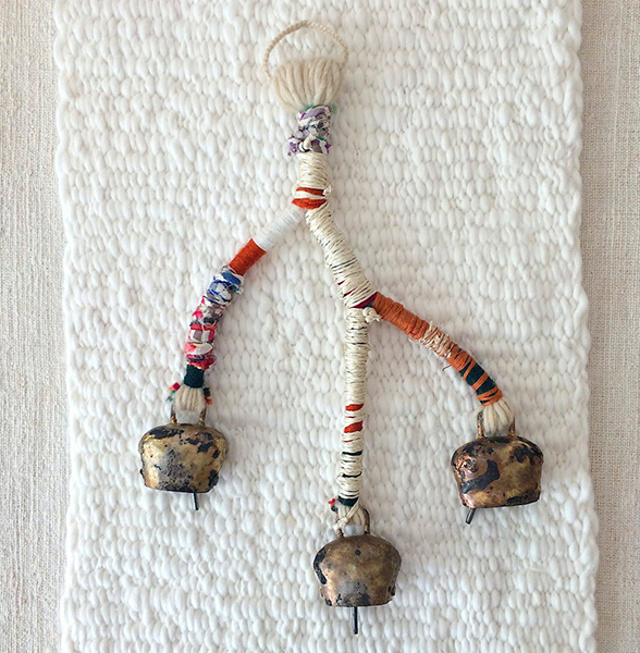 Handmade shepherd bells with recycled textiles and fiber | part of the Lost in Fiber artifact library and photographed on a VOZ woven panel (photo by Abigail Doan | NYC )
