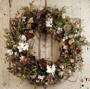This shabby chic wreath has an antique yet festive feel