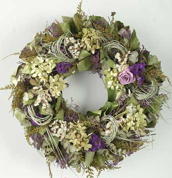 Summer greens and purple give this lovely wreath a natural, earthy feel