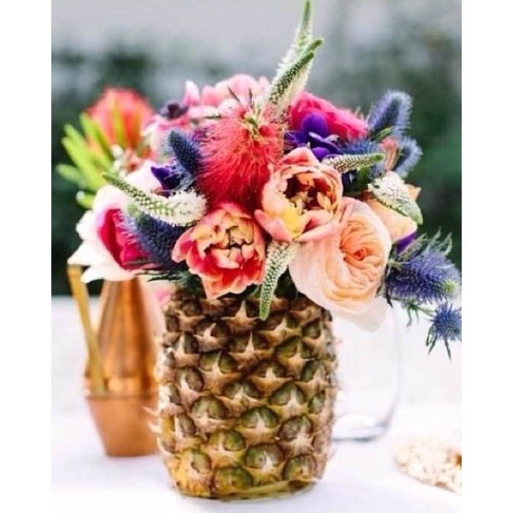 What's more fun than a tropical centerpiece arranged in a fresh pineapple?