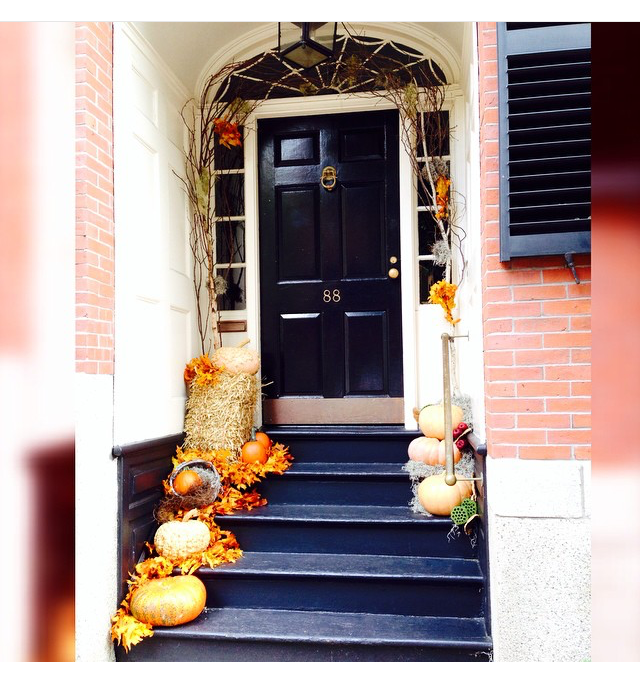 Here we've adorned a clients front entry way with a collection of ornamental pumpkins, gourds, dried branches and natural preserved autumn leaves.