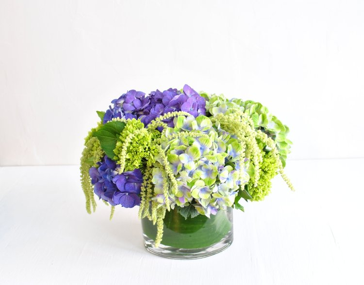 From our latest collection, Nantucket! The epitome of summers on the coast of New England, these gorgeous deep and variegated amethyst Dutch hydrangea pop against chartreuse mini green hydrangea and hanging amaranth.