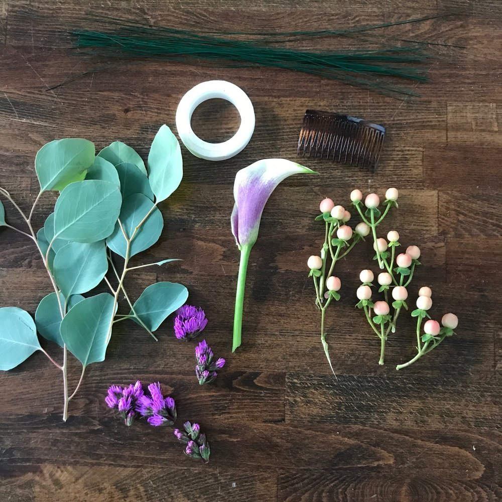 Step 1: Gather components for your comb. Ideally, one focal flower (in this case, the calla lily), a greenery (eucalyptus), and complimenting accents (liatris and hypericum)
