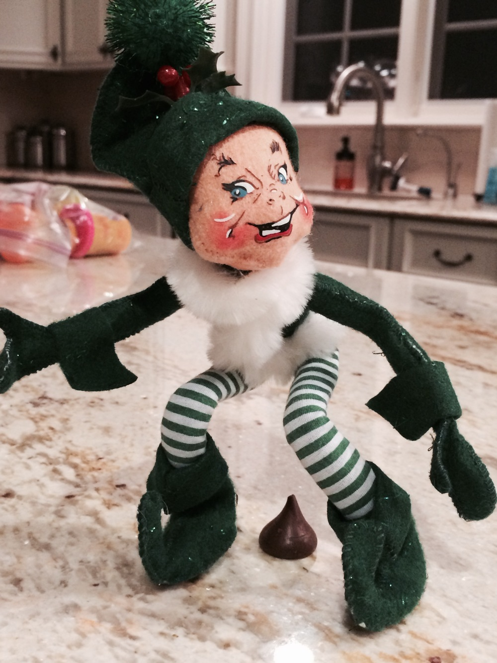 "I came downstairs one day during the holidays to find the ""elf on the shelf"" leaving a dirty little surprise for us.  (Our nanny thinks she's so damn funny.)"