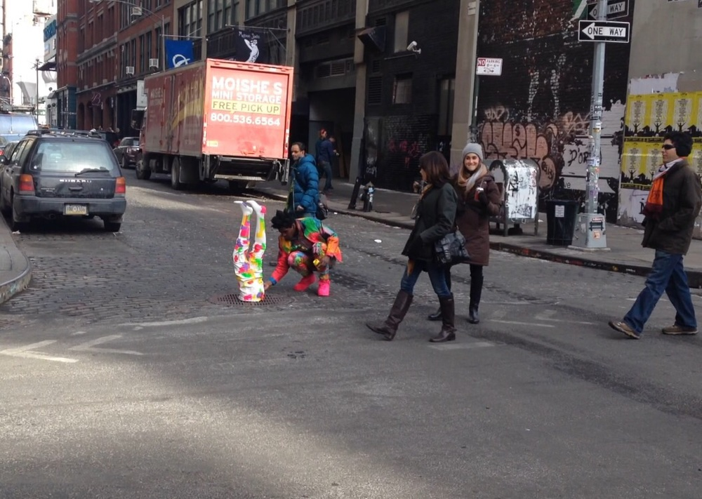 "This guy was just singing and dancing and painting his ""legs"" in the middle of the street in NYC.  Artists... *SMH..."