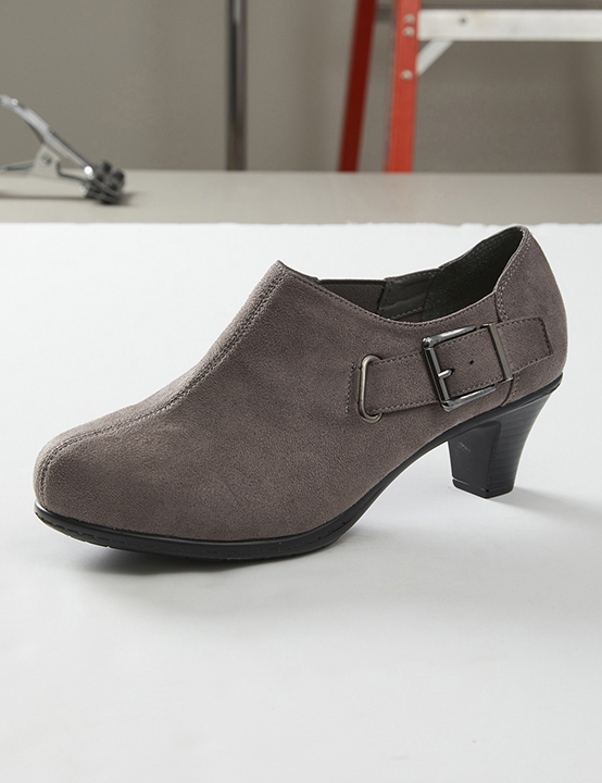 taupe suede ankle boot on white board