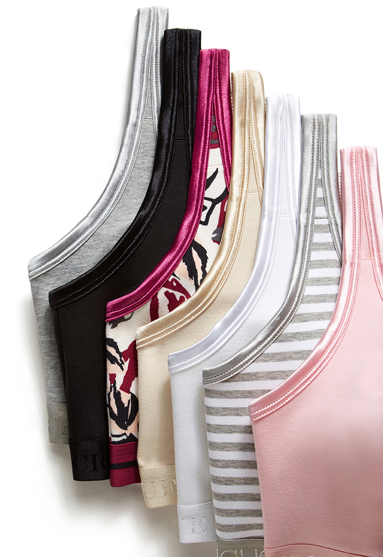 retouched stack of various bras on white background for product laydown