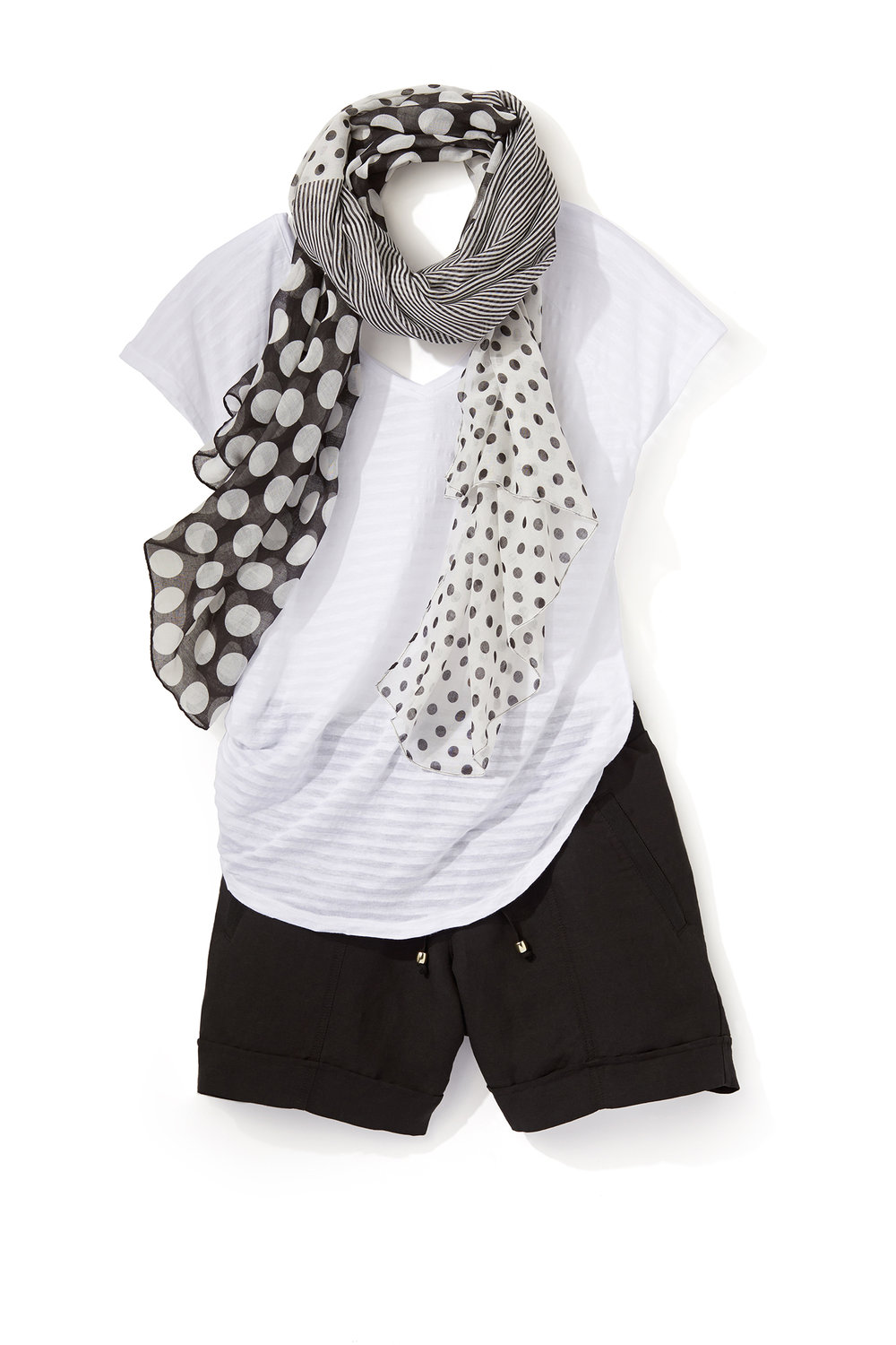 retouched laydown of white t-shirt and black shorts with black and white scarf on white background